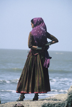 Indian woman (Rajasthani?) looking over the sea on Alibag beach.