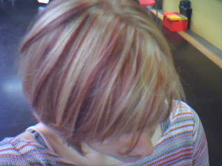 Stephanie with pink streaks in her hair.